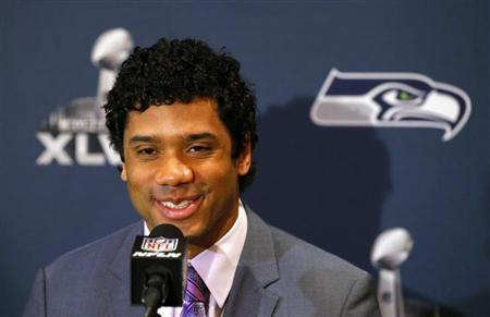 Seattle Seahawks quarterback Russell Wilson speaks during a news conference after the team's arrival for Super Bowl XLVIII against the Denver Broncos in Jersey City, New Jersey, January 26, 2014. REUTERS/Adam Hunger