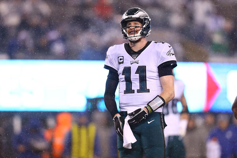 Carson Wentz will start his first playoff game on Sunday. (Photo by Mike Stobe/Getty Images)