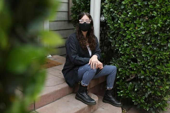LOS ANGELES, CA - APRIL 12: Shelby Bernstein, 29, feels anxiety seeing people gather at parks without masks or dining at outdoor restaurants and here poses for a portrait outside her home in Westlake on Monday, April 12, 2021 in Los Angeles, CA. (Dania Maxwell / Los Angeles Times)