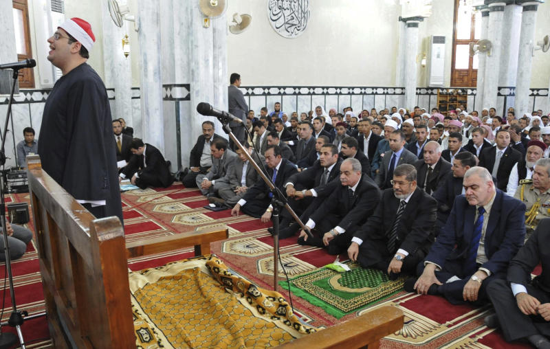 In this publicly diistributed photo released by the Egyptian Presidency, Egyptian President, Mohammed Morsi, front row second right, participates in Friday prayers in a mosque in Marsa Matruh, Egypt, Friday, Oct. 19, 2012.  (AP Photo/Egyptian Presidency)