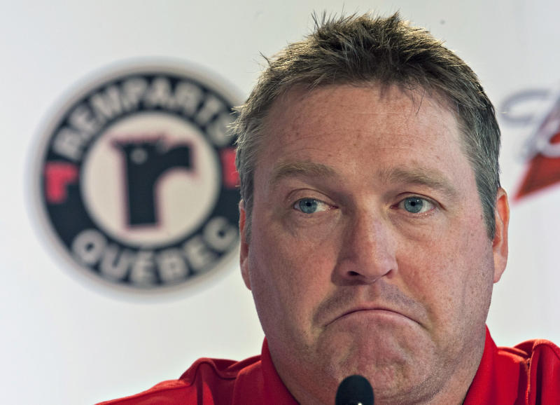 FILE - In this June 6, 2012 file photo, Quebec Remparts head coach and co-owner Patrick Roy reacts as he talks about Michel Therrien being named head coach of the Montreal Canadiens NHL team, during a news conference in Quebec City. Avalanche fans are talking about the possibility of Hall of Fame goalie Patrick Roy becoming the next coach of the Colorado team.  Roy's younger brother, Stephane Roy, posted a Facebook note late Monday night, May 20, 2013 saying his brother would be the new coach. (AP Photo/The Canadian Press, Jacques Boissinot, File)