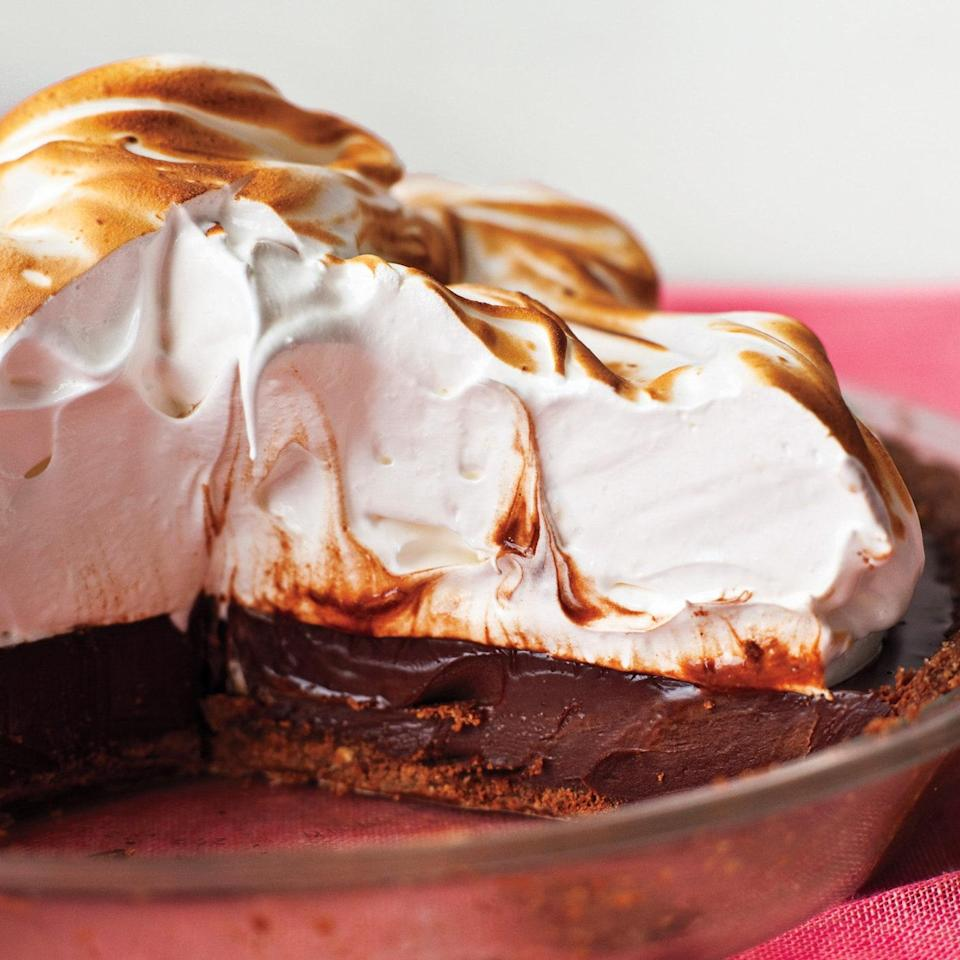 """This sophisticated mashup of the campfire classic uses Nutella to bind the graham cracker crust and coffee to deepen the chocolate flavor in the rich ganache filling. <a href=""""https://www.epicurious.com/recipes/food/views/coffee-smores-pie-51104720?mbid=synd_yahoo_rss"""" rel=""""nofollow noopener"""" target=""""_blank"""" data-ylk=""""slk:See recipe."""" class=""""link rapid-noclick-resp"""">See recipe.</a>"""