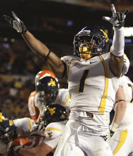 West Virginia wide receiver Tavon Austin (1) celebrates a touchdown by a teammate during the first half of the Orange Bowl NCAA college football game against Clemson, Wednesday, Jan. 4, 2012, in Miami. (AP Photo/J Pat Carter)