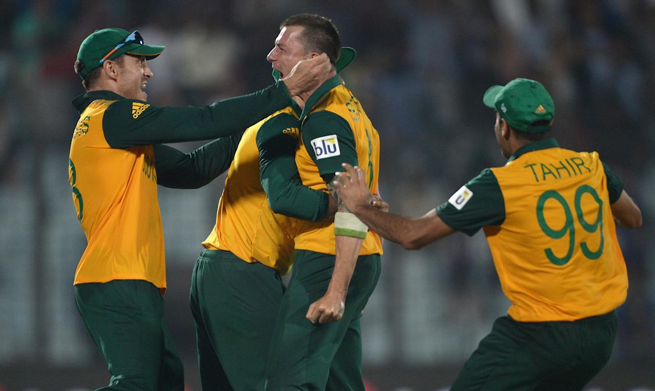 CHITTAGONG, BANGLADESH - MARCH 24:  Dale Steyn of South Africa celebrates with captain Faf du Plessis after running out Ross Taylor of New Zealand to win the ICC World Twenty20 Bangladesh 2014 Group 1 match between New Zealand and South Africa at Zahur Ahmed Chowdhury Stadium on March 24, 2014 in Chittagong, Bangladesh.  (Photo by Gareth Copley/Getty Images)