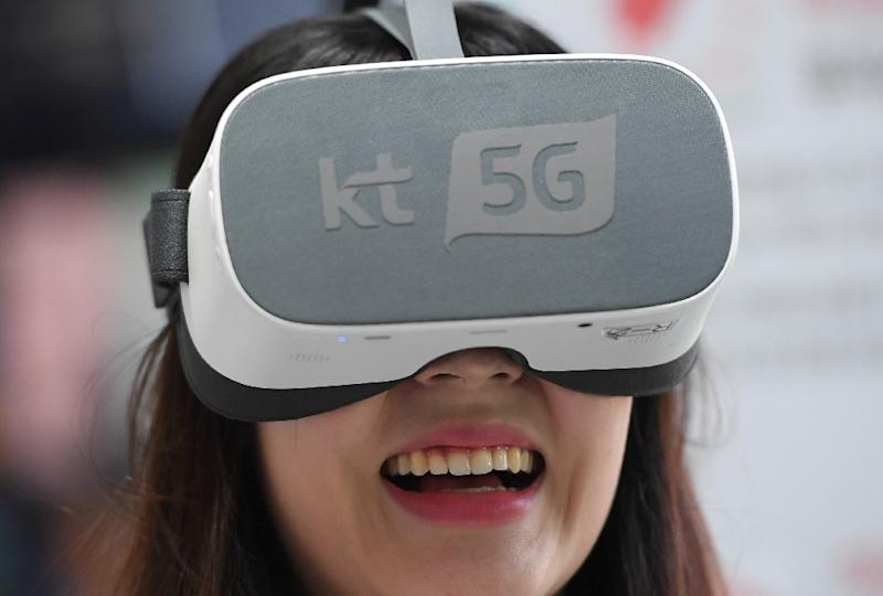 The new 5G technology will eventually be used to run everyday appliances including games machines, toasters, telephones and electric cars (AFP Photo/JUNG Yeon-Je)