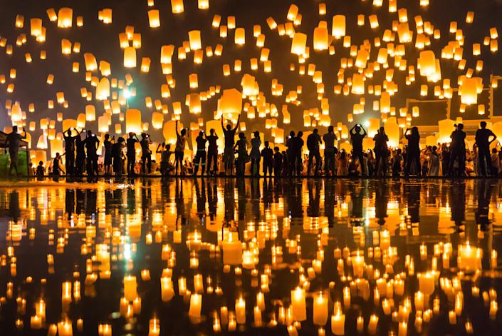 """The Thai government plans to reopen Chiang Mai on October 1 as part of the second phase of the country's reopening timeline, which is obviously great news for travelers. The news feels even greater when you remember that November marks Chiang Mai's annual Yi Peng lantern festival. Every year, on the full moon of the twelfth month of the Thai lunar calendar (Nov. 19-20 this year), the skies fill with thousands of glowing orange paper lanterns, which are released as a way of letting go of anything negative from the past year and inviting in the positive moving forward. There are tons of other reasons to visit Thailand's northern cultural capital, of course, from the thriving arts and design scene to steaming bowls of khao soi. When it comes to accommodations, you can't do much better than <a href=""""https://www.cntraveler.com/hotels/thailand/chiang-mai/the-chedi-chiang-mai?mbid=synd_yahoo_rss"""" rel=""""nofollow noopener"""" target=""""_blank"""" data-ylk=""""slk:Anantara Chiang Mai Resort"""" class=""""link rapid-noclick-resp"""">Anantara Chiang Mai Resort</a>. Although it's just a short tuk tuk ride away from Old Town, the property feels more like a country retreat, thanks to a bamboo wall encircling the entire resort, rooms with super-sized terraces, an infinity pool surrounded by lily ponds, and a decadent afternoon tea service."""