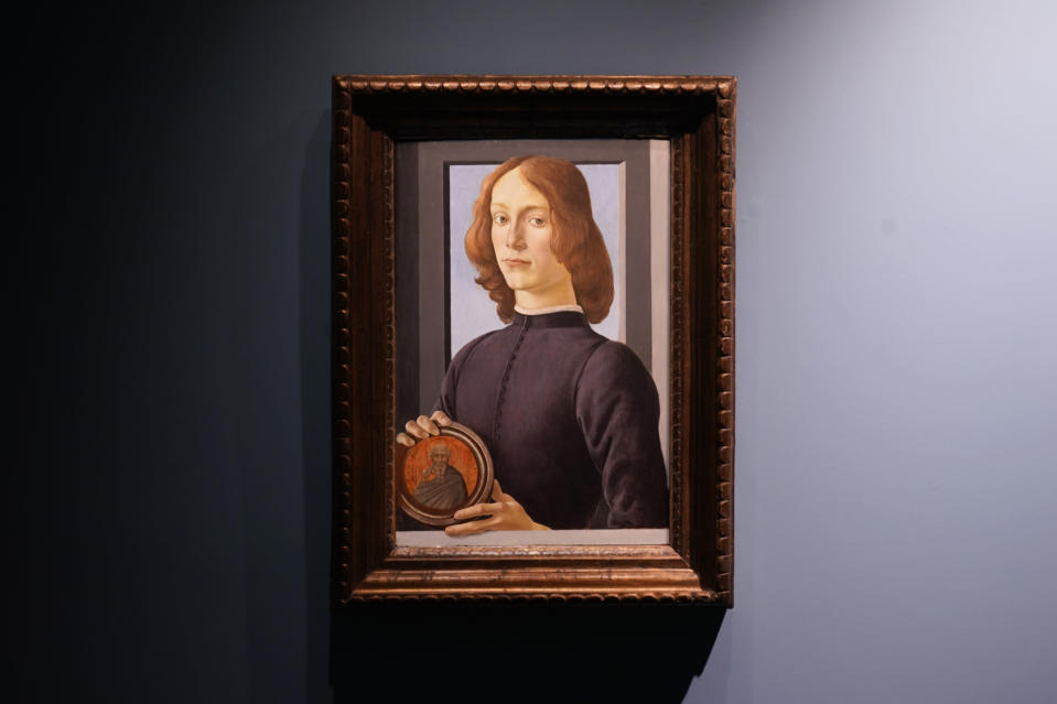 """Sandro Botticelli's 15th-century painting called """"Young Man Holding a Roundel"""" is displayed at Sotheby's on Sept. 23, 2020, in New York. The painting will go on auction next year and art watchers will be seeing if it fetches more than its eye-watering $80 million estimate, despite the pandemic. Botticelli's 15th-century portrait of a nobleman in """"Young Man Holding a Roundel"""" is the highlight of Sotheby's Masters Week sale series in New York in January. (AP Photo/Seth Wenig)"""