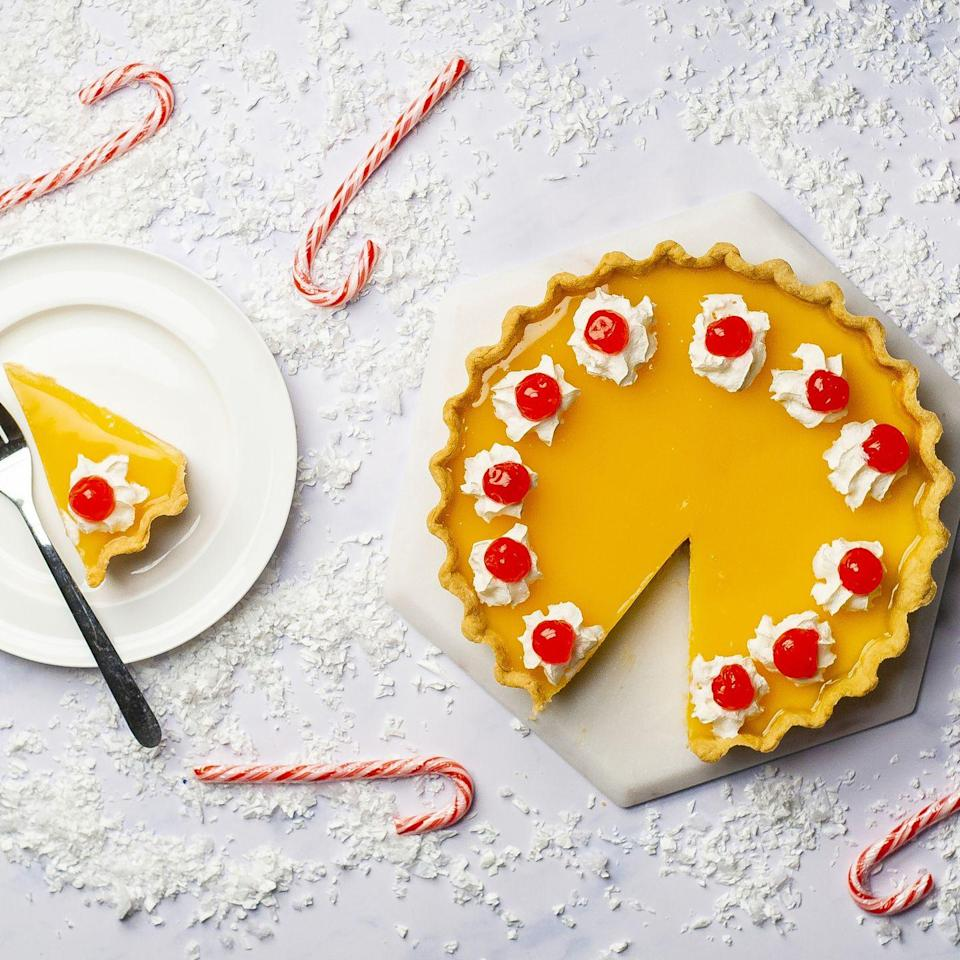 """<p>It doesn't get much more retro than this boozy custard tart. This old-school classic, with a nostalgic festive twist, is perfect for a dinner party.</p><p><strong>Recipe: <a href=""""https://www.goodhousekeeping.com/uk/christmas/christmas-recipes/a34698768/snowball-cocktail-tart/"""" rel=""""nofollow noopener"""" target=""""_blank"""" data-ylk=""""slk:Snowball Cocktail Tart"""" class=""""link rapid-noclick-resp"""">Snowball Cocktail Tart</a></strong></p>"""