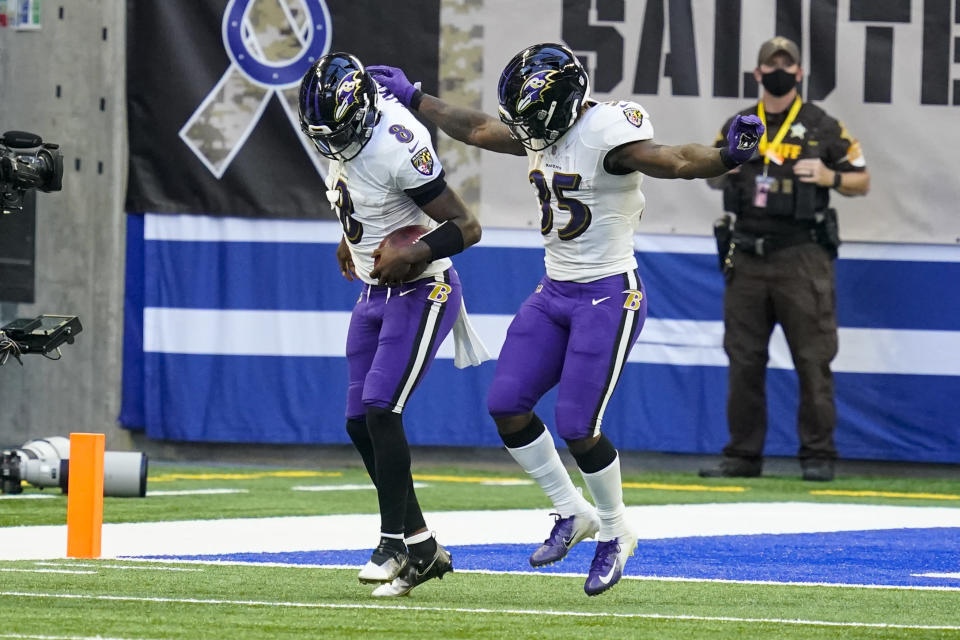 Baltimore Ravens quarterback Lamar Jackson (8) celebrates a touchdown with running back Gus Edwards (35) in the second half of an NFL football game against the Indianapolis Colts in Indianapolis, Sunday, Nov. 8, 2020. (AP Photo/Darron Cummings)