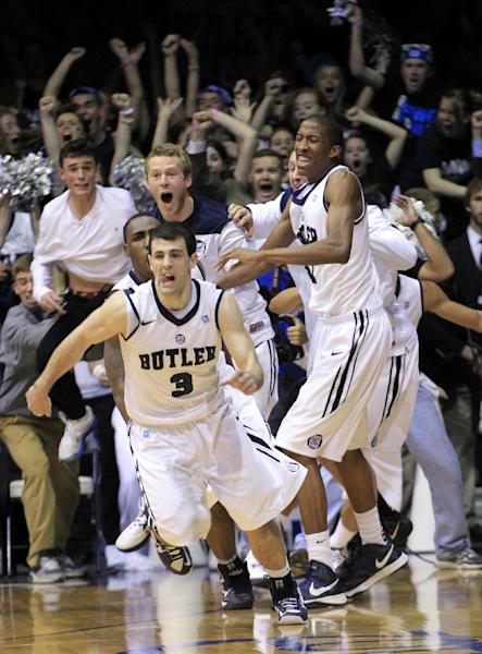 Butler guard Alex Barlow (3) leads the team onto the floor to celebrate a last-second basket that defeated Gonzaga in an NCAA college basketball game Saturday, Jan. 19, 2013, in Indianapolis. Butler won 64-63. (AP Photo/AJ Mast)