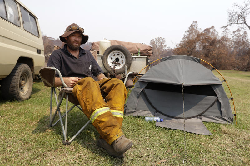 Mr Graham camps on the lawn near the fire station at Nerrigundah after losing his house. Source: AAP
