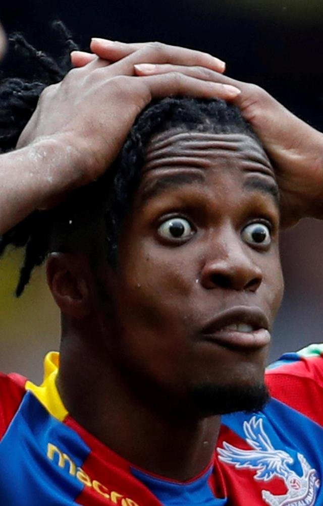 """Soccer Football - Premier League - Watford v Crystal Palace - Vicarage Road, Watford, Britain - April 21, 2018 Crystal Palace's Wilfried Zaha reacts after being shown a yellow card for simulation Action Images via Reuters/Paul Childs EDITORIAL USE ONLY. No use with unauthorized audio, video, data, fixture lists, club/league logos or """"live"""" services. Online in-match use limited to 75 images, no video emulation. No use in betting, games or single club/league/player publications. Please contact your account representative for further details. TPX IMAGES OF THE DAY"""