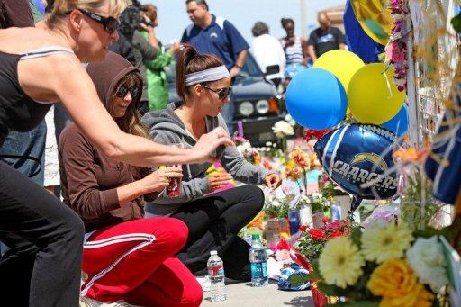 Wellwishers pay their respects at a memorial outside of Junior Seau's beach home in Oceanside, California