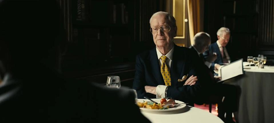 Michael Caine opposite John David Washington on his one day of filming Tenet. (Image by Warner Bros)