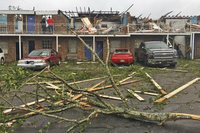 People survey the damage at a motel that was destroyed by a deadly tornado early Thursday, April 25, 2019 in Ruston, La. (Jonathan Elmer/The Tech Talk via AP)