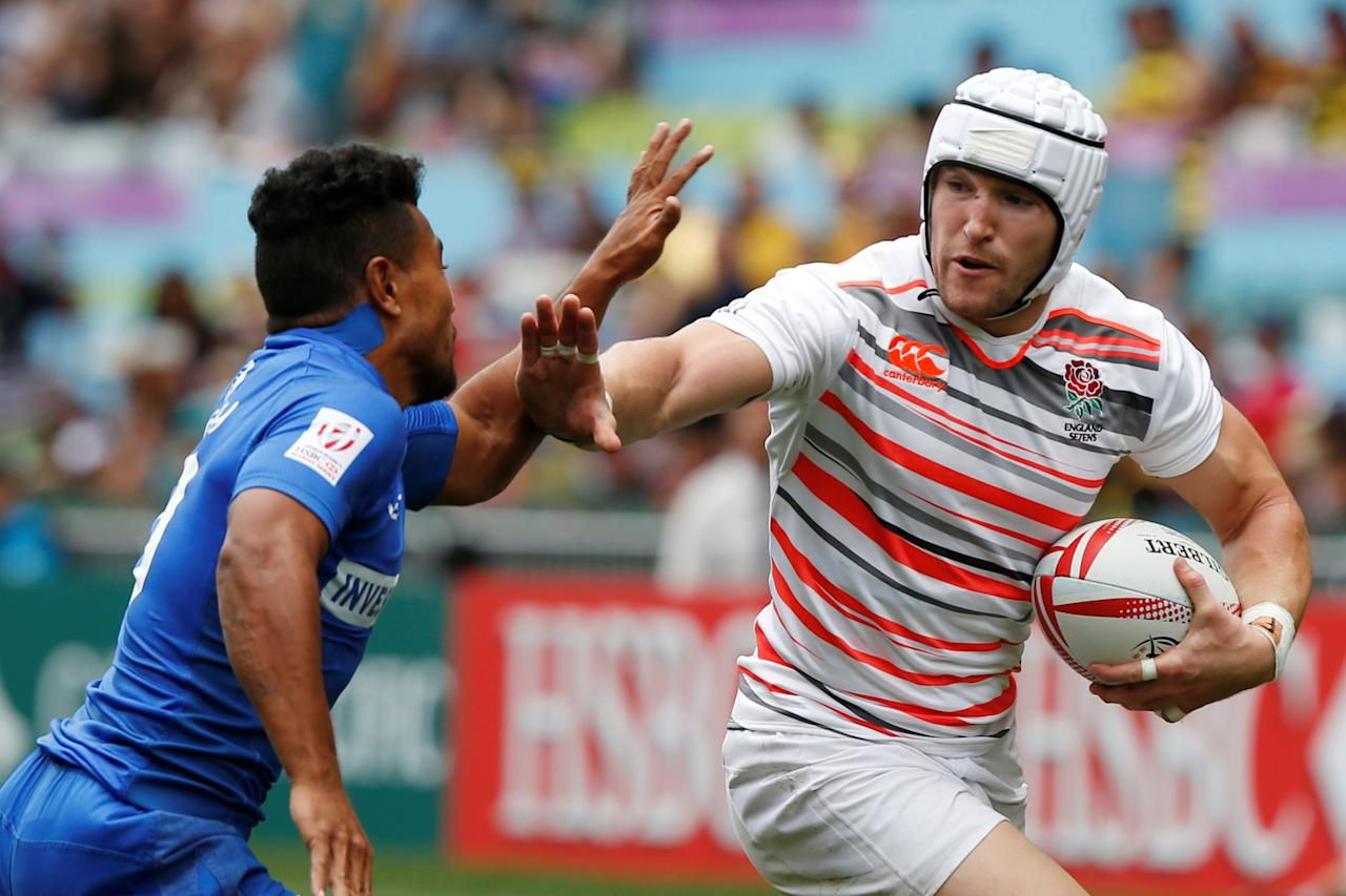 Rugby Union - England v Samoa - Hong Kong Sevens - Hong Kong Stadium, Hong Kong, China - 8/4/2017 - England's Phil Burgess (R) is tackled by Samoa's Samoa Toloa.  REUTERS/Bobby Yip