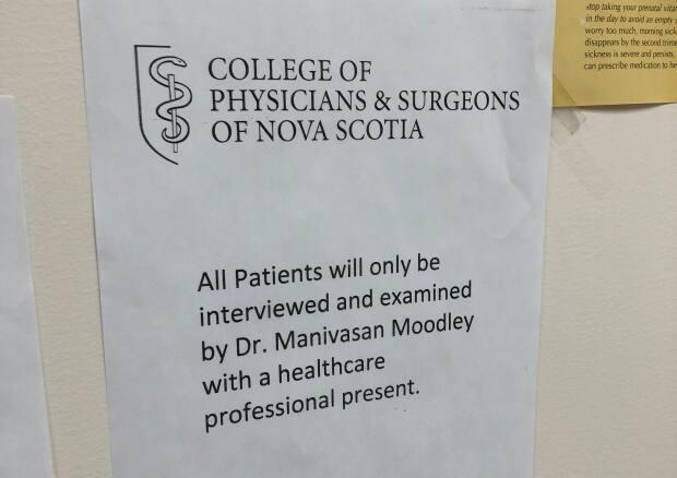 Dr. Manivasan Moodley, an obstetrician in Sydney, N.S., is required to have this notice from the College of Physicians and Surgeons of Nova Scotia posted in his waiting room. (Gary Mansfield/CBC - image credit)