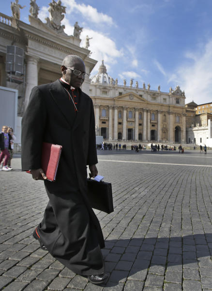 "FILE - In this Monday, March 4, 2013 file photo, Cardinal Robert Sarah, of Guinea, walks in St. Peter's Square after attending a cardinals' meeting, at the Vatican. Retired Pope Benedict XVI wrote the book, ""From the Depths of Our Hearts: Priesthood, Celibacy and the Crisis of the Catholic Church,"" along with his fellow conservative, Guinean Cardinal Robert Sarah, who heads the Vatican's liturgy office and has been a quiet critic of Francis. (AP Photo/Andrew Medichini, File)"