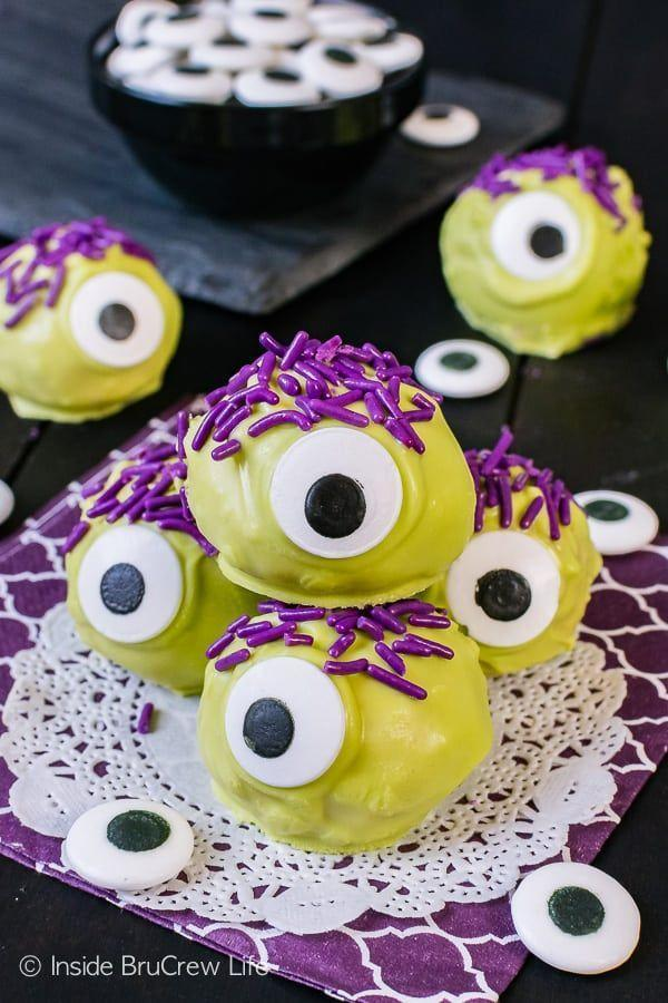 """<p>Here's one you can make with the kids! They'll love decorating these silly, one-eyed creatures.</p><p><strong>Get the recipe at <a href=""""https://insidebrucrewlife.com/peanut-butter-monsters/"""" rel=""""nofollow noopener"""" target=""""_blank"""" data-ylk=""""slk:Inside BruCrew Life"""" class=""""link rapid-noclick-resp"""">Inside BruCrew Life</a>.</strong></p><p><strong><strong><strong><a class=""""link rapid-noclick-resp"""" href=""""https://go.redirectingat.com?id=74968X1596630&url=https%3A%2F%2Fwww.walmart.com%2Fbrowse%2Fhome%2Ffood-storage-containers%2Fthe-pioneer-woman%2F4044_623679_1032619_5842891%2FYnJhbmQ6VGhlIFBpb25lZXIgV29tYW4ie&sref=https%3A%2F%2Fwww.thepioneerwoman.com%2Ffood-cooking%2Fmeals-menus%2Fg32110899%2Fbest-halloween-desserts%2F"""" rel=""""nofollow noopener"""" target=""""_blank"""" data-ylk=""""slk:SHOP FOOD STORAGE"""">SHOP FOOD STORAGE</a></strong></strong><br></strong></p>"""