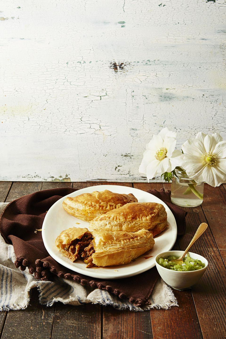 "<p>Wrap those leftovers in puff pastry blankets and you have a completely different, delicious dinner.</p><p><a href=""https://www.goodhousekeeping.com/food-recipes/a37308/quick-n-easy-empanadas-recipe/"" rel=""nofollow noopener"" target=""_blank"" data-ylk=""slk:Get the recipe for Quick 'n' Easy Empanadas »"" class=""link rapid-noclick-resp""><em>Get the recipe for Quick 'n' Easy Empanadas »</em></a></p>"