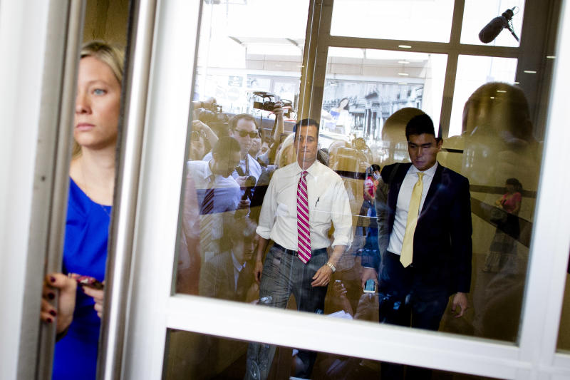 New York City mayoral candidate Anthony Weiner prepares to exit the Nan Shan Senior Center and face reporters after speaking to voters at a campaign stop, Monday, July 29, 2013, in the Queens borough of New York. Weiner confirmed that campaign manager Danny Kedem resigned Saturday after reports surfaced that Weiner continued to exchange lewd photos and messages with women despite resigning from Congress in 2011 over the same behavior. (AP Photo/John Minchillo)