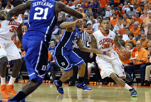 Clemson's K.J. McDaniels, right, drives to the basket past Duke's Andre Dawkins and Amile Jefferson (21) during an NCAA college basketball game in Clemson, S.C., on Saturday, Jan. 11, 2014. (AP Photo/The Independent-Mail, Mark Crammer)