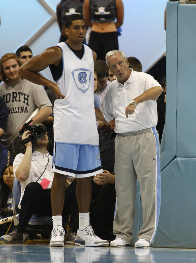 """North Carolina head coach Roy Williams, right, instructs James Michael McAdoo during a scrimmage at """"Late Night With Roy,"""" a kickoff to the college basketball season in Chapel Hill, N.C. on Friday, Oct. 25, 2013. (AP Photo/Nell Redmond)"""