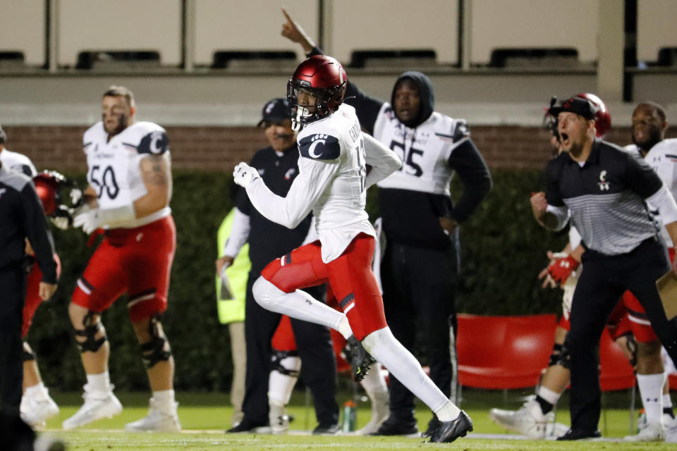 FILE - Cincinnati's Ahmad Gardner (12) takes the ball down the sideline for a touchdown following an interception against East Carolina during the second half of an NCAA college football game in Greenville, N.C., in this Saturday, Nov. 2, 2019, file photo. Gardner was selected to The Associated Press Preseason All-America first team defense, Monday Aug. 23, 2021. (AP Photo/Karl B DeBlaker, File)