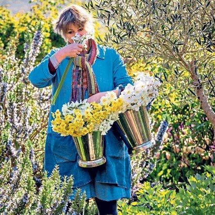 Sarah Raven, with buckets of daffodils in her garden at Perch Hill, East Sussex - Jonathan Buckley