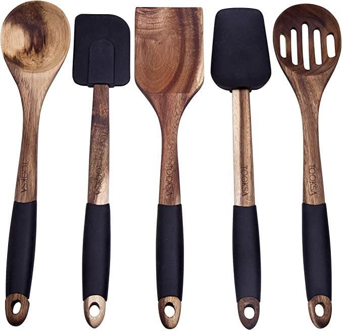 <p>The <span>Tooksa Premium 5 Piece Acacia Utensil Set</span> ($25) is another essential that new home cooks need!</p>