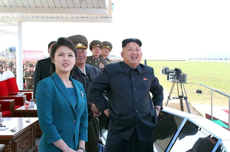 Undated photo released on May 11, 2014 shows North Korean leader Kim Jong-Un and his wife Ri Sol-Ju at an airfield at an undisclosed location in North Korea (AFP Photo/)