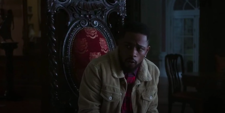 LaKeith Stanfield sitting on an ornate chair