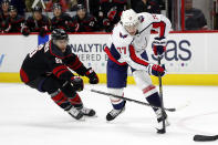 Carolina Hurricanes' Teuvo Teravainen (86), of Finland, tries to block the shot of Washington Capitals' T.J. Oshie (77) during the first period of an NHL hockey game in Raleigh, N.C., Friday, Jan. 3, 2020. (AP Photo/Karl B DeBlaker)