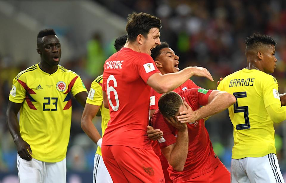 <p>Jordan Henderson holds his face after Wilmar Barrios puts his head where he shouldn't </p>