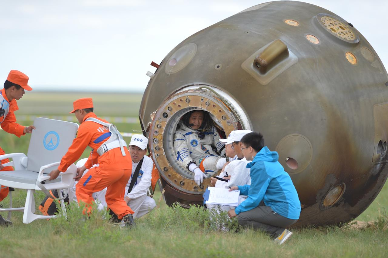 INNER MONGOLIA, CHINA - JUNE 26: (CHINA OUT) Re-entry capsule of Shenzhou X spacecraft touched down successfully at around 8:07 am Beijing Time Wednesday at the main landing site on June 26, 2013 in Inner Mongolia Autonomous Region of China. The Astronauts return after a 15-day trip to a prototype space station. (Photo by ChinaFotoPress/ChinaFotoPress via Getty Images)