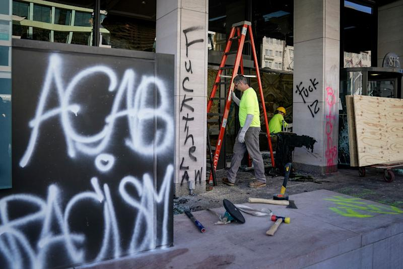 ACAB can be seen spray painted outside a business. Source: Getty