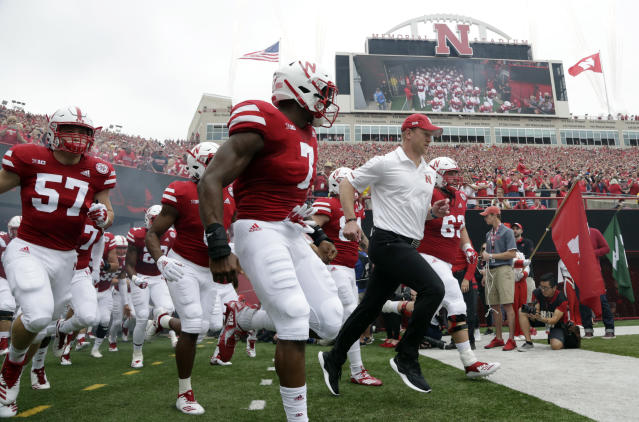 Nebraska head coach Scott Frost leads his players onto the field before the first half of an NCAA college football game against Colorado in Lincoln, Neb., Saturday, Sept. 8, 2018. (AP Photo/Nati Harnik)