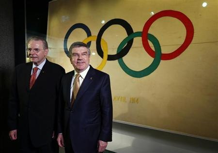 International Olympic Committee (IOC) President Thomas Bach (R) poses with his predecessor Jacques Rogge in a new presentation room at the Olympic Museum in Lausanne December 10, 2013. REUTERS/Denis Balibouse