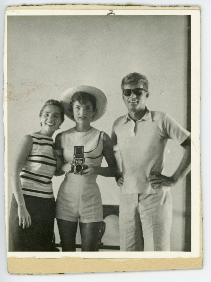 This undated photo provided by John McInnis Auctioneers in Amesbury, Mass., shows late President John F. Kennedy, right, with his wife, Jacqueline, center, and sister-in-law Ethyl Kennedy, left. The photograph is among items to be auctioned Sunday, Feb. 17, 2013. The family of David Powers, a former special assistant to President John F. Kennedy, is auctioning hundreds of photographs, documents, gifts and other memorabilia that once belonged to the late president. (AP Photo/John McInnis Auctioneers)