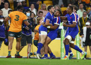 France's Baptiste Couilloud, centre, reacts with teammates after scoring a try during the third rugby international between France and Australia at Suncorp Stadium in Brisbane, Australia, Saturday, July 17, 2021. (AP Photo/Tertius Pickard)