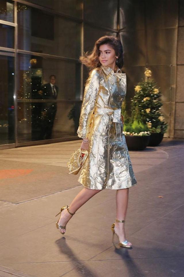 <p>Zendaya started the morning off looking like a dream in all gold. She matched a Giuseppe di Morabito coat with Paul Andrew shoes and her signature side-swept curls. (Photo: Getty Images) </p>