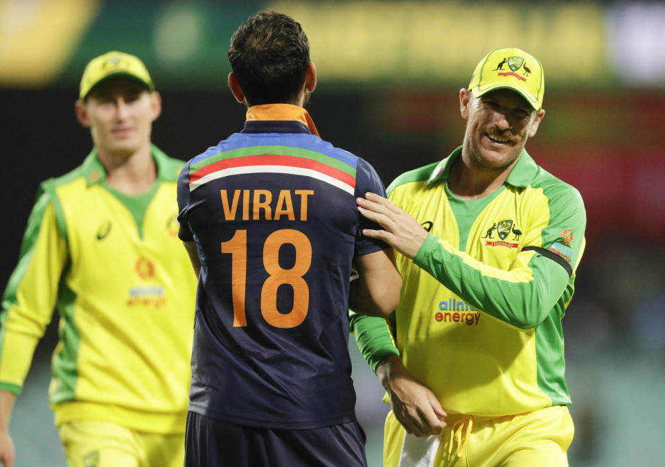 India's Virat Kohli congratulates Australia's Aaron Finch, right, after the one day international cricket match between India and Australia at the Sydney Cricket Ground in Sydney, Australia, Friday, Nov. 27, 2020.Australia defeated India by 66 runs. (AP Photo/Rick Rycroft)