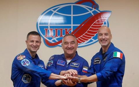NASA astronaut Andrew Morgan, Alexander Skvortsov of the Russian space agency Roscosmos and Luca Parmitano of European Space Agency (ESA) pose after their final news conference ahead of their launch to the International Space Station (ISS), at the Baikonur Cosmodrome, Kazakhstan, July 19, 2019 - Credit: Reuters