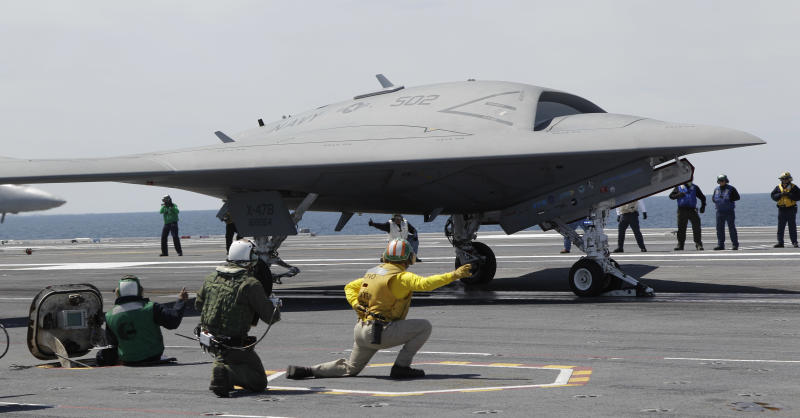 FILE - A Navy X-47B drone is launched off the nuclear powered aircraft carrier USS George H. W. Bush off the coast of Virginia, in this May 14, 2013 file photo. The Navy says the X-47B experimental aircraft will try to land aboard the USS George H.W. Bush on Wednesday July 10, 2013. (AP Photo/Steve Helber, File)