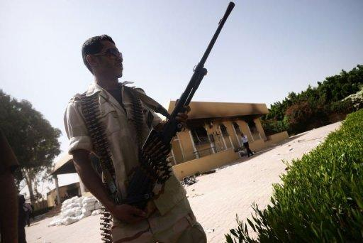 A member of the Libyan security forces secures the area near the US consulate in Benghazi