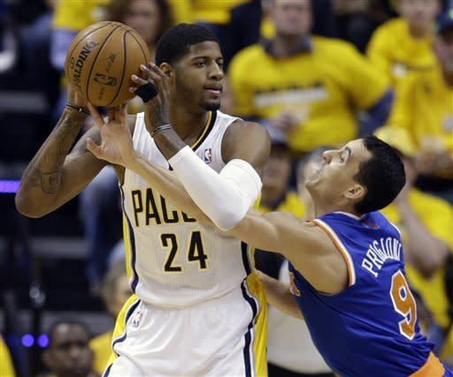 New York Knicks' Pablo Prigioni (9) tries to steal the ball from Indiana Pacers' Paul George (24) during the first half of Game 3 of an Eastern Conference semifinal NBA basketball playoff series in Saturday, May 11, 2013, in Indianapolis. (AP Photo/Darron Cummings)