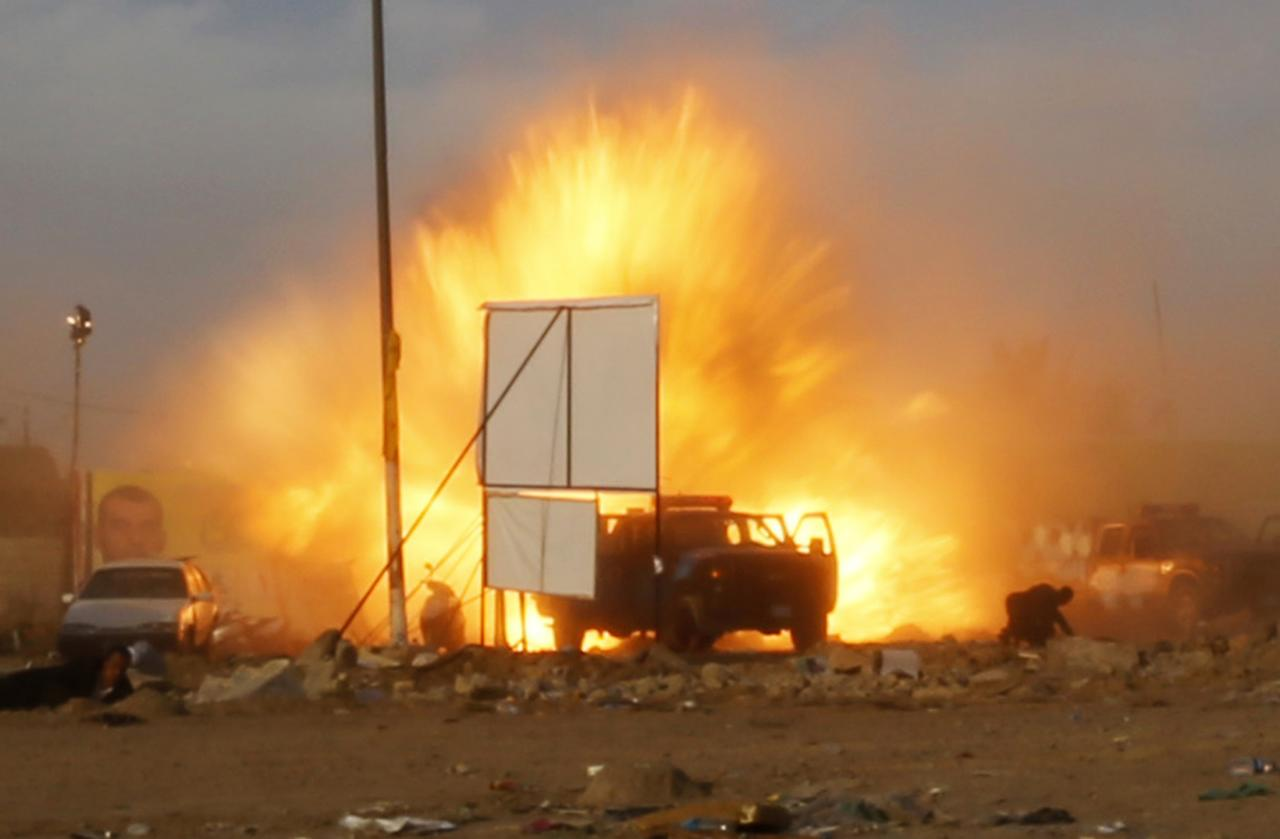An explosion is seen during a car bomb attack at a Shi'ite political organisation's rally in Baghdad, April 25, 2014. A series of explosions killed 18 people at a Shi'ite political organisation's rally in Iraq on Friday, police and medical sources said. The militant group, Asaib Ahl Haq (League of the Righteous), introduced its candidates for elections on April 30 at the rally in eastern Baghdad. Three bombs exploded in succession as people were leaving, Reuters reporters at the scene said. REUTERS/Thaier al-Sudani (IRAQ - Tags: CIVIL UNREST POLITICS TPX IMAGES OF THE DAY)
