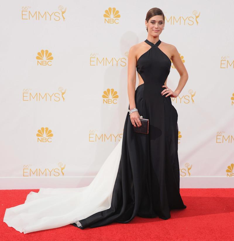 Lizzy Caplan, in Donna Karan, arrives at the 66th Annual Primetime Emmy Awards at Nokia Theatre L.A. Live on August 25, 2014 in Los Angeles, California.