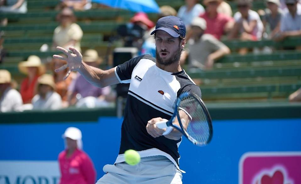 Spain's Feliciano Lopez hits a return against Gilles Simon during their Kooyong Classic match in Melbourne on January 12, 2016 (AFP Photo/Mal Fairclough)