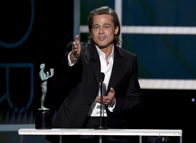 LOS ANGELES, CALIFORNIA - JANUARY 19: Brad Pitt accepts Outstanding Performance by a Male Actor in a Supporting Role for 'Once Upon a Time in Hollywood' onstage during the 26th Annual Screen Actors Guild Awards at The Shrine Auditorium on January 19, 2020 in Los Angeles, California. 721359 (Photo by Kevork Djansezian/Getty Images for Turner)